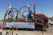 عربات زهور تابعة لشركة اسيوط لتكرير البترول تطوف المحافظة احتفالا بعيدها القومي